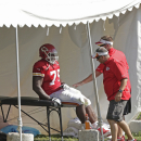 Kansas City Chiefs offensive linesman Donald Stephenson (79) is tended to by trainers after being injured while participating in a drill at NFL football training camp Sunday, July 27, 2014, in St. Joseph, Mo. (AP Photo/Charlie Riedel)