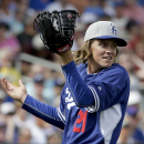 Greinke struggles, Lester shines in Cubs' win over Dodgers The Associated Press