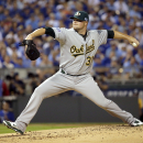 Oakland Athletics starting pitcher Jon Lester throws during the first inning of the AL wild-card playoff baseball game against the Kansas City Royals Tuesday, Sept. 30, 2014, in Kansas City, Mo. (AP Photo/Charlie Riedel)