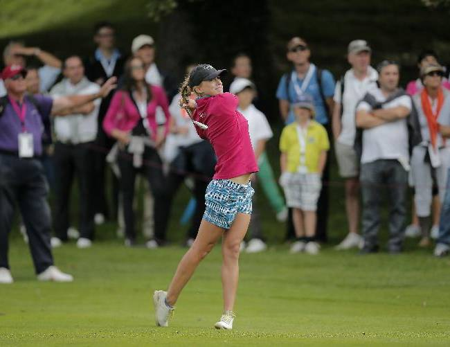 Belen Mozo, of Spain, plays on the 1st hole during the second round of the Evian Championship women's golf tournament in Evian, eastern France, Saturday, Sept. 14, 2013