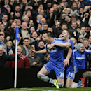 Chelsea s captain John Terry, left, celebrates after scoring his team s second goal against Southampton, along with his teammate Gary Cahill, right, during their English Premier League soccer match at the Stamford bridge ground in London, Sunday, Dec. 1,