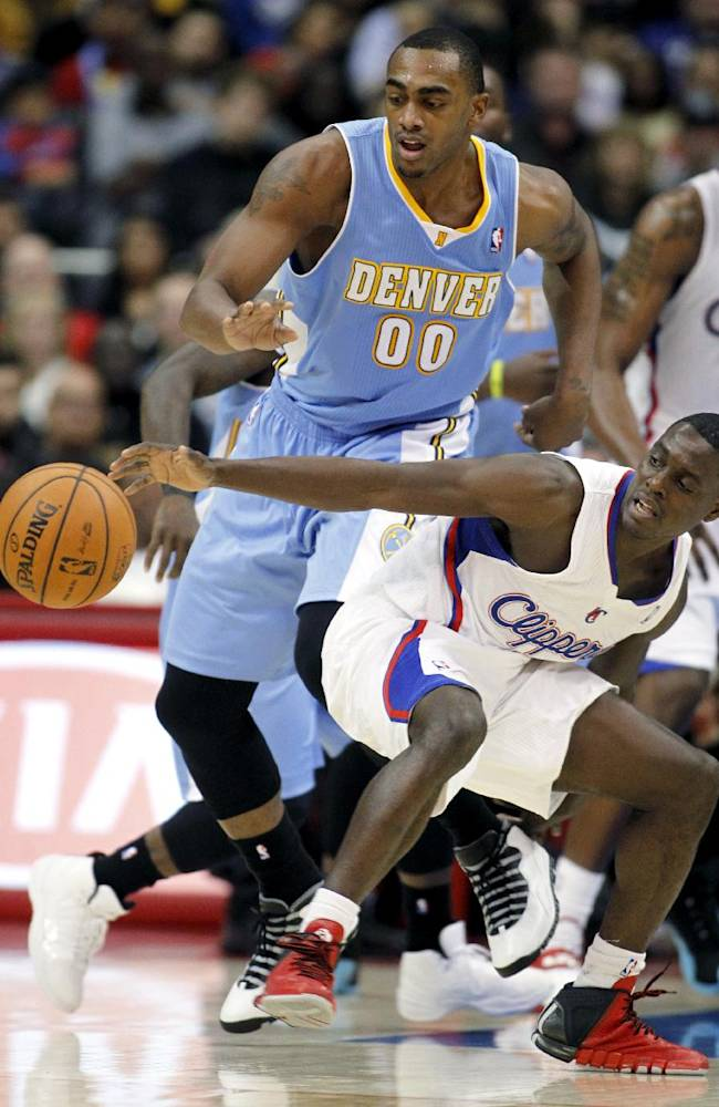 Los Angeles Clippers guard Darren Collison, right, loses control of the ball as Denver Nuggets forward Darrell Arthur (00) is there to make the steal in the second half of an NBA basketball game in Los Angeles on Saturday, Dec. 21, 2013. Clippers won 112-91
