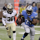Detroit Lions running back Reggie Bush (21) is chased by New Orleans Saints defensive back Marcus Ball (36) during the first half of an NFL football game in Detroit, Sunday, Oct. 19, 2014 The Associated Press