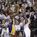 Los Angeles Lakers guard Jodie Meeks, left, scored a three-point shot over Sacramento Kings guard Ben McLemore in the closing moments of the Lakers to a 106-100 win over the Kings in a NBA basketball game in Sacramento, Calif., Friday, Dec. 6, 2013 The As
