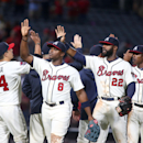 Atlanta Braves' Justin Upton (8), Jason Heyward (22) and B.J. Upton (2) celebrate their win over the Washington Nationals in a baseball game on Saturday, April 12, 2014, in Atlanta. Atlanta won 6-3 The Associated Press