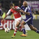 Arsenal's Mathieu Flamini, left, and Anderlecht's Anthony Vanden Borre vie for the ball during the Group D Champions League match between Anderlecht and Arsenal at Constant Vanden Stock Stadium in Brussels, Belgium, Wednesday Oct. 22, 2014
