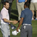 In this photo made May 12, 2013, Sergio Garcia, of Spain, left, shakes hands with Tiger Woods at the end of the third round of The Players championship golf tournament at TPC Sawgrass in Ponte Vedra Beach, Fla. Garcia apologized to Woods on Wednesday, May 22, 3013, for saying he would have