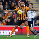 Hull City's Tom Huddlestone, left, is challenged by West Bromwich Albion's Craig Gardner during the English Premier League soccer match at the KC Stadium, Hull, England, Saturday Dec. 6, 2014