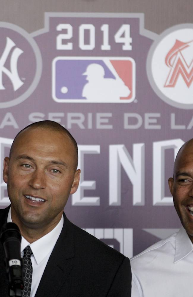 New York Yankees captain Derek Jeter, left, and retired baseball pitcher Mariano Rivera, smile during a press conference in Panama City, Saturday, March 15, 2014. The New York Yankees are in Panama to play a pair of exhibition games against the Miami Marlins in the home country of Rivera, the retired career saves leader.  Part of the Legend Series, the Saturday and Sunday games at the Rod Carew Stadium highlight a weekend that is a tribute to Rivera, who retired after last season