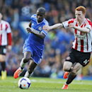 Chelsea's Ramires, left, tries to dribble past Sunderland's Jack Colback, right, during their English Premier League soccer match at the Stamford Bridge ground in London, Saturday, April 19, 2014