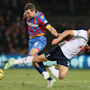 Crystal Palace's James McArthur, left, tussles with Tottenham Hotspur's Nacer Chadli during the English Premier League soccer match between Crystal Palace and Tottenham Hotspur at Selhurst Park, London, England, Saturday, Jan. 10, 2015