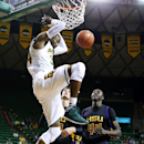 Baylor forward Cory Jefferson, left, scores over Hardin-Simmons Jim Walker, bottom left, and Mawen Maywin in the first half of an NCAA college basketball game, Sunday, Dec. 1, 2013, in Waco, Texas. (AP Photo/The Waco Tribune-Herald, Rod Aydelotte)