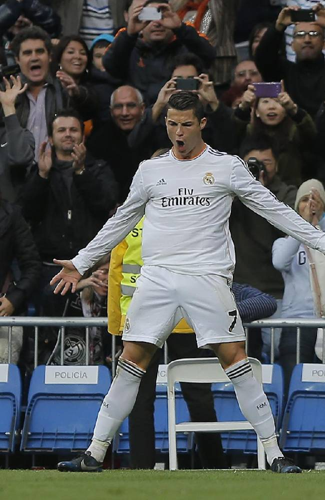 Real Madrid's Cristiano Ronaldo celebrates his third goal during a Spanish La Liga soccer match between Real Madrid and Real Sociedad at the Santiago Bernabeu stadium in Madrid, Spain, Saturday, Nov. 9 , 2013