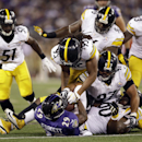 Baltimore Ravens running back Justin Forsett (29) is tackled by several Pittsburgh Steelers, including outside linebacker Jarvis Jones (95), defensive end Cameron Heyward (97) and nose tackle Steve McLendon (90), during the first half of an NFL football g