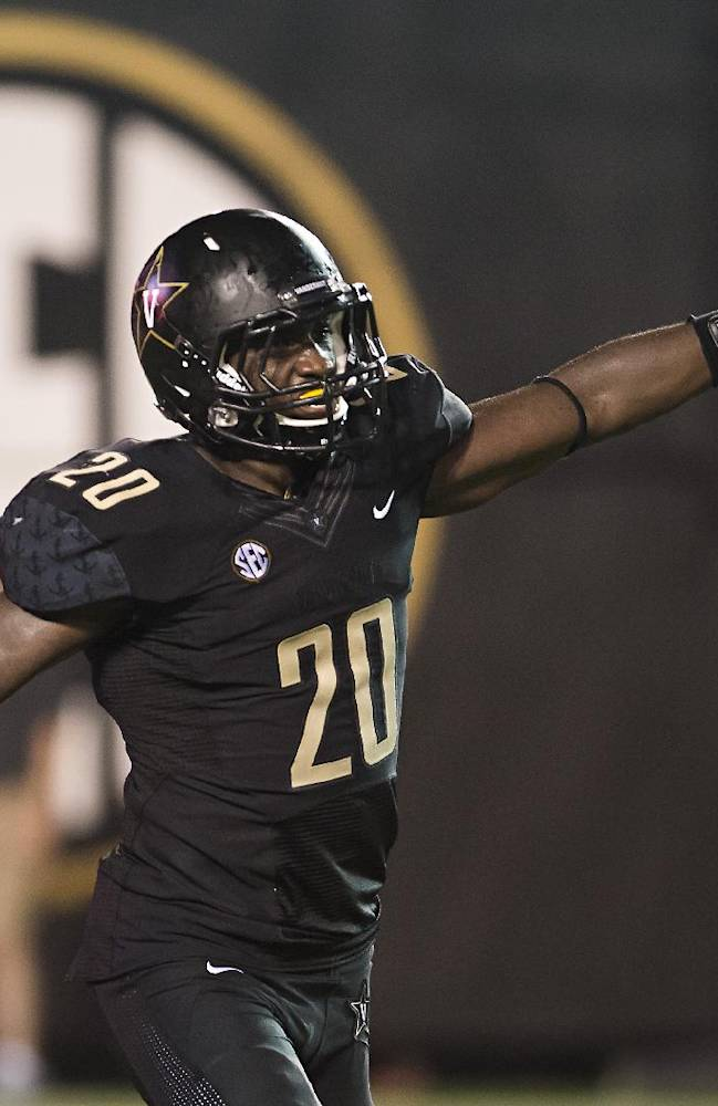 Vanderbilt's Oren Burks celebrates after recovering a fumbled Temple snap in the end zone in the second quarter of an NCAA college football game Thursday, Aug. 28, 2014, in Nashville, Tenn