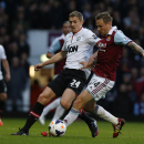 West Ham United's Matt Taylor, right, competes with Manchester United's Darren Fletcher during their English Premier League soccer match at Upton Park, London, Saturday, March 22, 2014