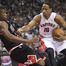Toronto Raptors forward DeMar DeRozan, right, knocks down Chicago Bulls forward forward Jimmy Butler, left, during first-half NBA basketball game action in Toronto, Friday, Nov. 15, 2013 The Associated Press