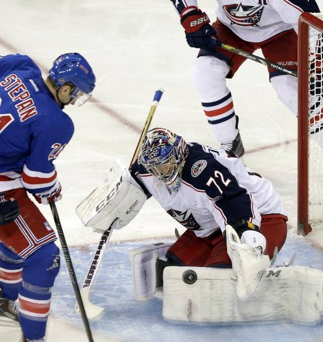 Columbus Blue Jackets goalie Sergei Bobrovsky (72) stops a shot on the goal by New York Rangers' Derek Stepan (21) during the third period of an NHL hockey game Monday, Jan. 6, 2014, in New York. The Blue Jackets won the game 4-3 in a shootout