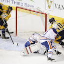 Nashville Predators center Mike Ribeiro (63) scores against Edmonton Oilers goalie Viktor Fasth (35), of Sweden, in the first period of an NHL hockey game Tuesday, Nov. 11, 2014, in Nashville, Tenn. At right are Oilers defenseman Andrew Ference (21) and P