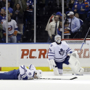 Toronto Maple Leafs goalie Jonathan Bernier (45) and teammate Tim Gleason (8) react after New York Islanders' Lubomir Visnovsky scored in overtime of an NHL hockey game Thursday, Feb. 27, 2014, in Uniondale, N.Y. The Islanders won 5-4 The Associated Press