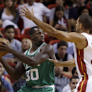 Boston Celtics' Brandon Bass (30) looks to pass as Miami Heat's Shane Battier defends during the first half of an NBA basketball game Saturday, Nov. 9, 2013, in Miami The Associated Press