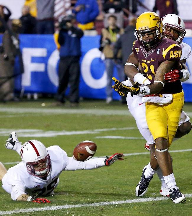 Stanford's Ed Reynolds, left, and Wayne Lyons break up a pass intended for Arizona State's Jaelen Strong (21) during the second half of the NCAA Pac-12 Championship football game Saturday, Dec. 7, 2013, in Tempe, Ariz.  Stanford defeated Arizona State 38-14