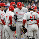 Philadelphia Phillies pitching coach Bob McClure, right, talks to starter A.J. Burnett, catcher Carlos Ruiz and infielders during the first inning of a baseball game against the Chicago Cubs in Chicago, Sunday, April 6, 2014 The Associated Press