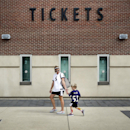 Kristen Moyer receives a high-five from her son Tyler, 4, after they traded in his Baltimore Ravens running back Ray Rice jersey, Friday, Sept. 19, 2014, at M&T Bank Stadium in Baltimore. The Ravens offered fans a chance to trade in their Rice jerseys for
