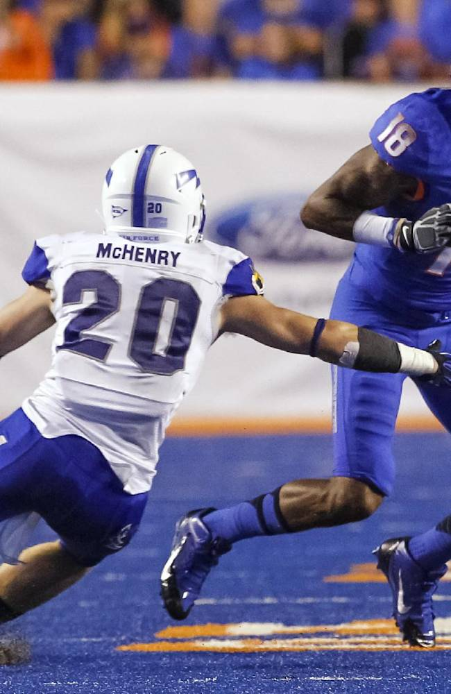 Boise State wide receiver Aaron Burks (18) runs the ball past Air Force defensive back Gavin McHenry (20) during the second half of an NCAA college football game in Boise, Idaho, Friday, Sept. 13, 2013. Boise State won 42-20