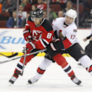 New Jersey Devils right wing Dainius Zubrus (8), of Lithuania, and Ottawa Senators center David Legwand (17) compete for the puck during the first period of an NHL hockey game, Tuesday, Feb. 3, 2015, in Newark, N.J The Associated Press