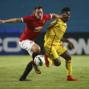 Manchester United Phil Jones (left) and Liverpool Raheem Sterling (31) battle for the ball during the finals of the Guinness International Championship Cup soccer match in Miami, Gardens, Fla., Monday, July 4, 2014. (AP Photo/J Pat Carter)