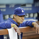 Los Angeles Dodgers manager Don Mattingly watches from the dugout before the Dodgers' baseball game against the Philadelphia Phillies on Thursday, April 24, 2014, in Los Angeles The Associated Press
