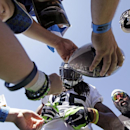Seattle Seahawks' Richard Sherman signs autographs following an NFL football training camp practice Sunday, July 27, 2014, in Renton, Wash The Associated Press