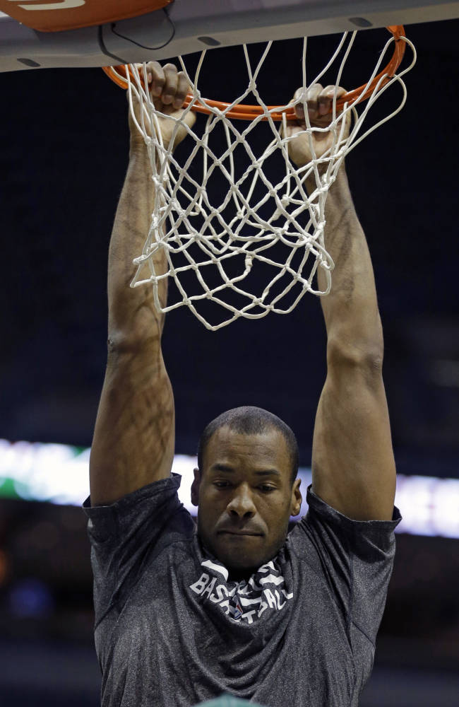 Brooklyn Nets' Jason Collins dunks before an NBA basketball game against the Milwaukee Bucks Saturday, March 1, 2014, in Milwaukee. (AP Photo/Jeffrey Phelps)