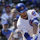 Chicago Cubs' Kris Bryant swings and misses to strike out during the fifth inning of a baseball game against the San Diego Padres in Chicago, Friday, April 17, 2015. (AP Photo/Nam Y. Huh)