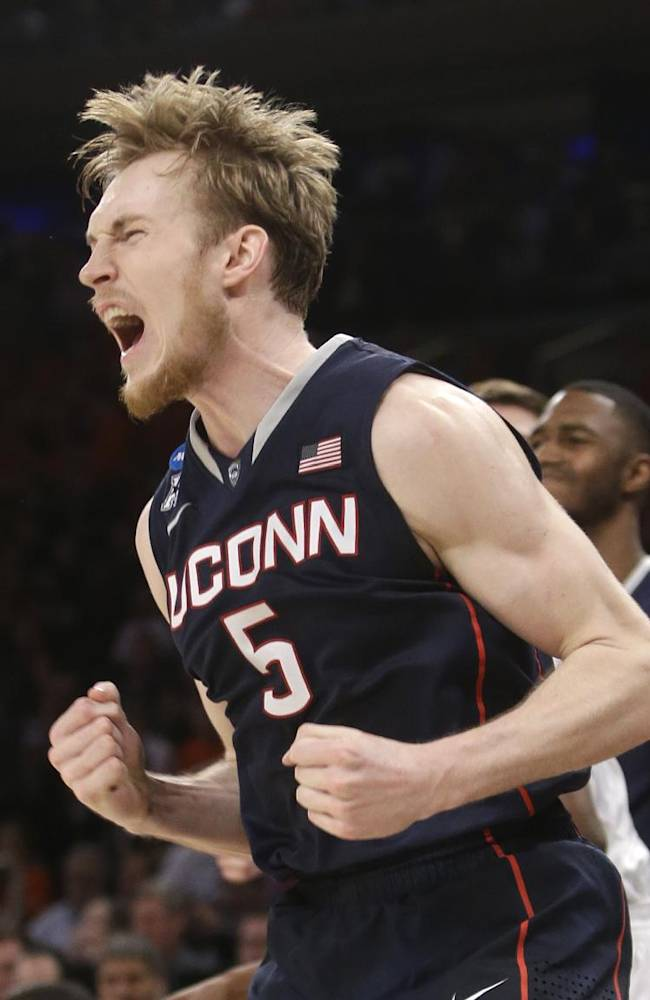 Connecticut's Niels Giffey exults during the second half in a regional semifinal against Iowa State in the NCAA men's college basketball tournament Friday, March 28, 2014, in New York. Connecticut won 81-76