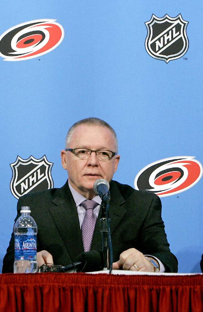 Carolina Hurricanes' new associate coach Ron Francis, left, President and General manager Jim Rutherford, and new head coach Paul Maurice, right, answer questions during a news conference to announce a coaching change in Raleigh, N.C., Wednesday, Dec. 3, 2008. The Hurricanes fired head coach Peter Laviolette Wednesday