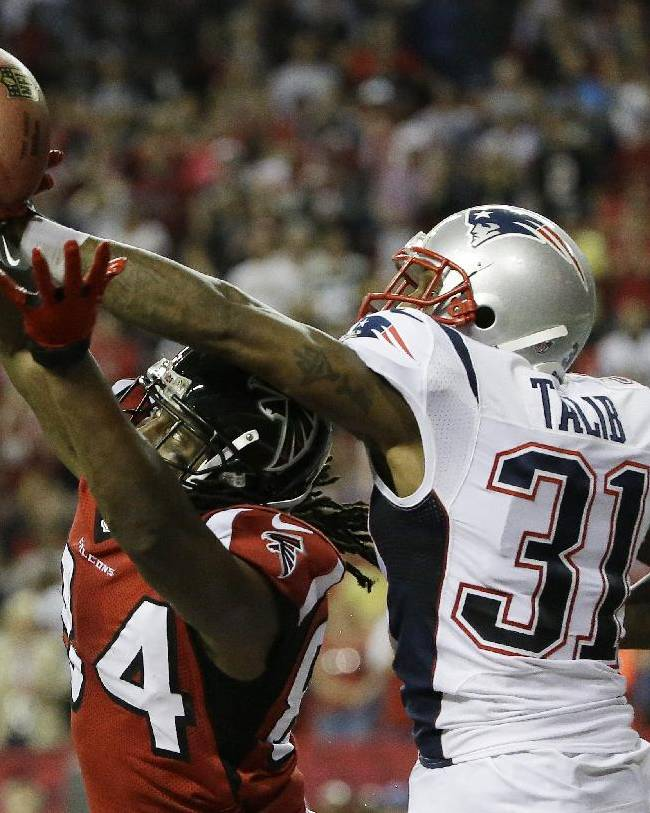 New England Patriots cornerback Aqib Talib (31) breaks up a pass intended for Atlanta Falcons wide receiver Roddy White (84) during the second half of an NFL football game, Sunday, Sept. 29, 2013, in Atlanta. The New England Patriots won 30-23
