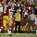 Washington Redskins quarterback Kirk Cousins walks off the field after an interception during the second half of an NFL football game against the New York Giants in Landover, Md., Thursday, Sept. 25, 2014. (AP Photo/Alex Brandon)
