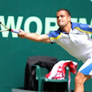 Russia's Mikhail Youzhny returns a shot to Kei Nishikori of Japan during their match at the ATP tennis tournament in Halle, Germany, Wednesday, June 12, 2013. (AP Photo/dpa, Oliver Krato)