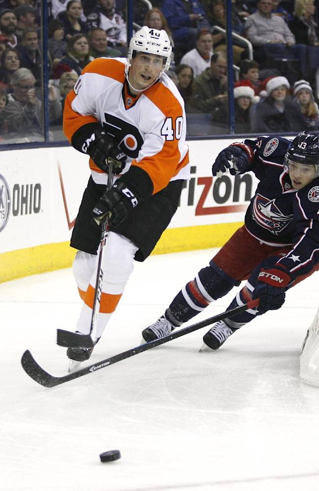 Columbus Blue Jackets' Cam Atkinson (13) chases Philadelphia Flyers' Vincent Lecavlier (40) during the second period of an NHL hockey game on Saturday, Dec. 21, 2013, in Columbus, Ohio