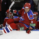 Former NHL star Slava Fetisov jumps on ice during the Continental Hockey League (KHL) ice hockey match between CSKA Moscow and SKA St.Petersburg in Moscow, Russia, Friday, Dec. 11, 2009. The defenseman and former captain of the Soviet Union national team ended his professional career at age 40 after winning a second straight Stanley Cup with the Detroit Red Wings in 1998. Fetisov is president of CSKA and a member of the upper house of Russia's parliament. (AP Photo/Ivan Sekretarev)