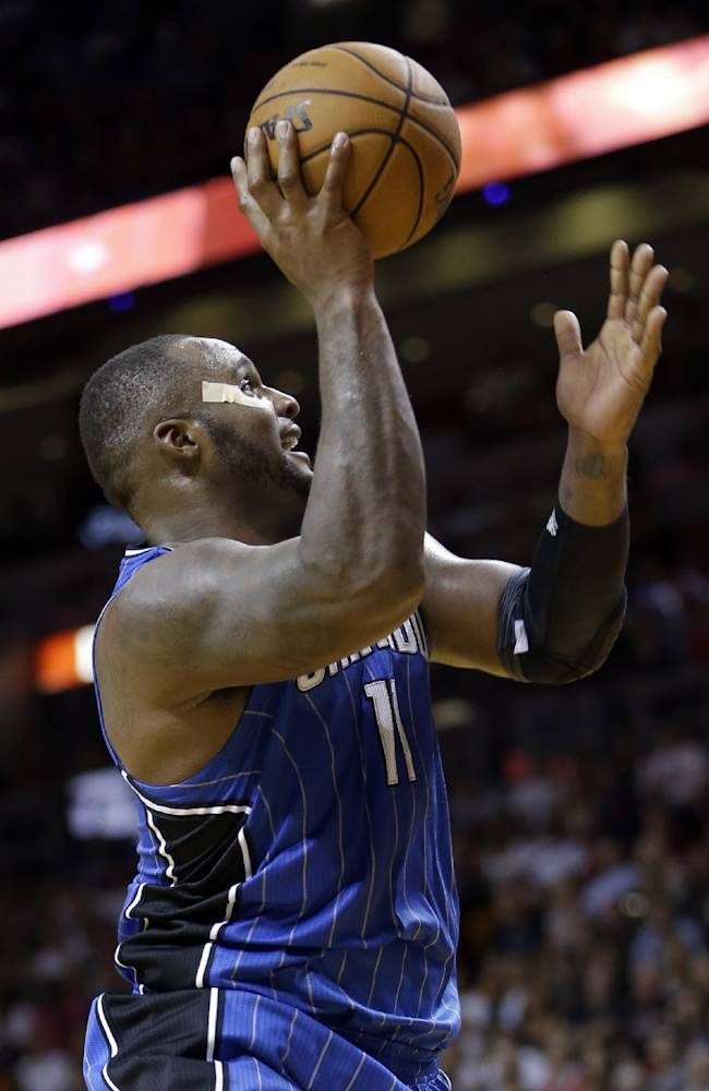 Orlando Magic power forward Glen Davis (11) goes up for a shot against the Miami Heat in the fourth quarter of an NBA basketball game, Saturday, Nov. 23, 2013, in Miami. The Heat won 101-99