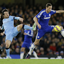 Chelsea's Nemanja Matic, right, vies for the ball with Manchester City's David Silva during the English Premier League soccer match between Chelsea and Manchester City at Stamford Bridge stadium in London, Saturday, Jan. 31, 2015