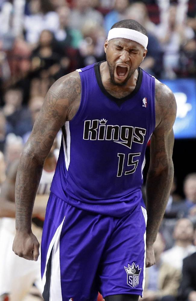 Sacramento Kings center DeMarcus Cousins reacts after sinking a 3-point shot during the second half of an NBA basketball game against the Portland Trail Blazers in Portland, Ore., Wednesday, April 9, 2014.  Cousins topped the Kings in scoring with 30 points and pulled in 12 rebounds. The Trail Blazers won 100-99