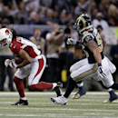 Arizona Cardinals' Larry Fitzgerald (11) is chased by St. Louis Rams' James Laurinaitis (55) following a catch during the first half of an NFL football game Thursday, Dec. 11, 2014 in St. Louis The Associated Press