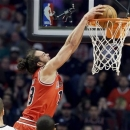 Chicago Bulls center Joakim Noah, top, dunks against the Brooklyn Nets during the first half of an NBA basketball game in Chicago on Saturday, March 2, 2013. (AP Photo/Nam Y. Huh)