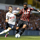 Tottenham Hotspur's Erik Lamela, left, competes for the ball with Queens Park Rangers' Armand Traore during their English Premier League soccer match at White Hart Lane, London, Sunday, Aug. 24, 2014