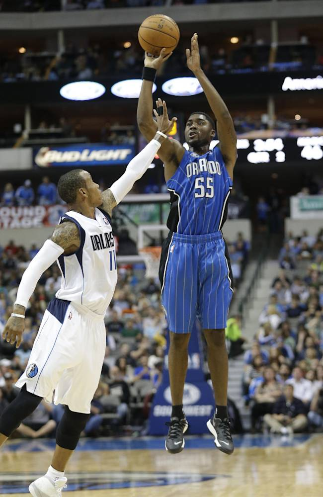 Orlando Magic shooting guard E'Twaun Moore (55) shoots against Dallas Mavericks point guard Monta Ellis (11) during the first half of an NBA preseason basketball game in Dallas,  Monday, Oct. 14, 2013