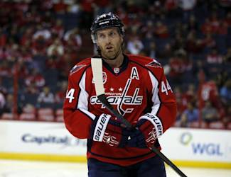 Washington Capitals defenseman Brooks Orpik (44) pauses on the ice before the start of the second period of Game 1 in the first round of the NHL hockey Stanley Cup playoffs against the New York Islanders, Wednesday, April 15, 2015, in Washington. (AP Photo/Alex Brandon)